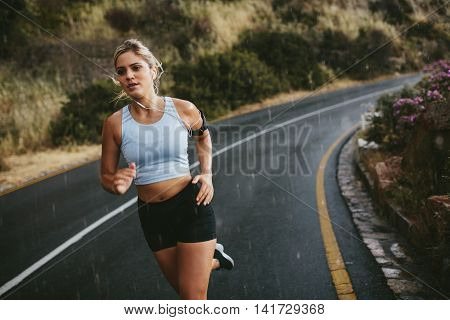 Fit Young Woman Running On Highway