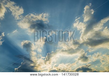 Sunbeam through the clouds on blue sky: can be used as background and dramatic look