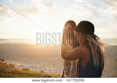 Female Friends Walking On The Sea Shore
