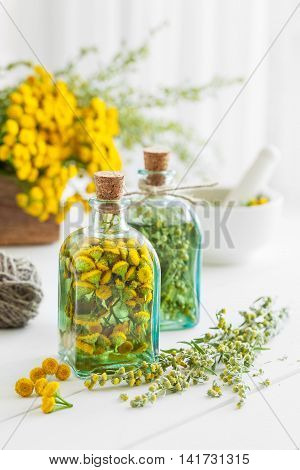 Tincture Bottles Of Tansy And Tarragon Healthy Herbs, Healing Herbs In Wooden Box And In Mortar. Her