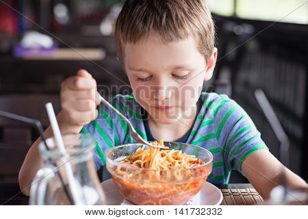 Little 7 Years Old Boy Child Eating Spaghetti Bolognese