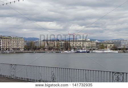 GENEVA SWITZERLAND - APRIL 11: Exterior views of the buildings and fountain at the Geneva Lake on April 11 2015. Its the second most populous city in Switzerland