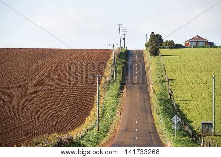 Rural Road Past Ploughed Field