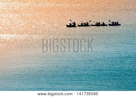 Sea Canoeists (water Sports) At Dawn