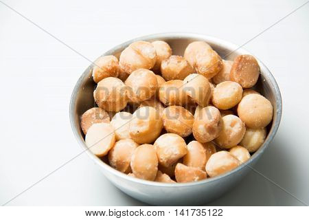 A Macadamia Nut in isolated white background