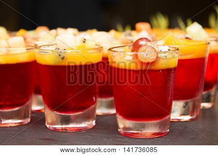 A Strawberry jelly in nimi glass fruit on top