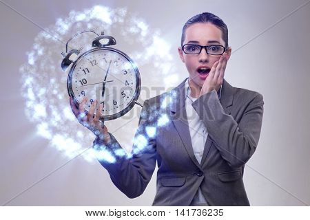 Young businesswoman in tight deadline concept