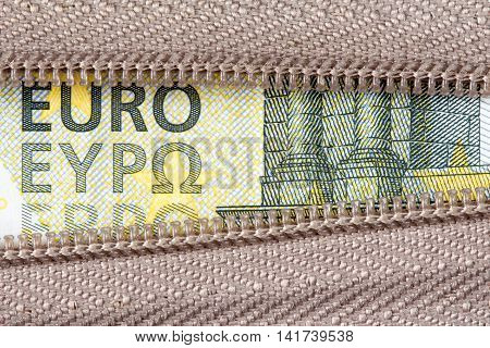Business money concept with five Euro and zipper