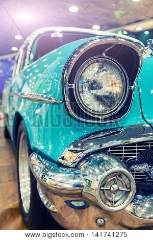 retro american car headlight close-up toning point of view
