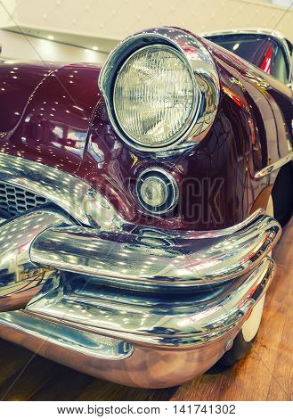 Color detail on the headlight of a vintage american car.