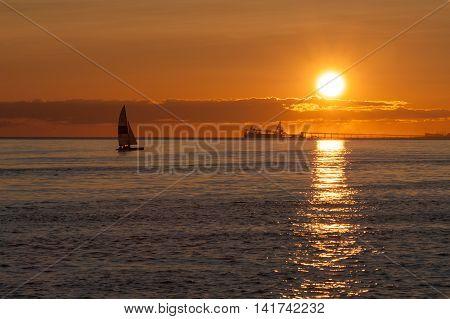 Point Roberts Washington State USA : June 28 2009 : sail and ship at sunset on Pacific ocean at Point Roberts Washington USA
