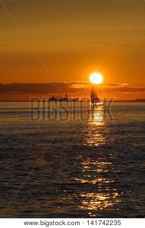 Point Roberts Washington State USA : June 28 2009 :sail and ship at sunset on Pacific ocean at Point Roberts Washington USA