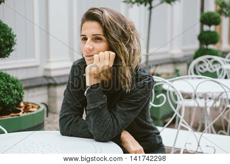 Young Woman Waiting For A Friend At The Table.