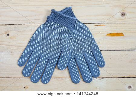 Gloves On Wooden Background Top View