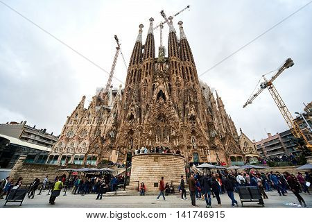 Barcelona Spain - April 4 2016: Sagrada Familia is a large Roman Catholic church in Barcelona designed by Spanish architect Antoni Gaudi. Unesco World Heritage Site. Spain