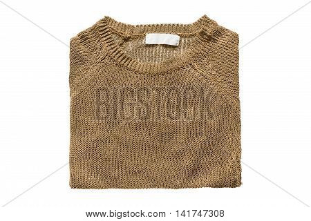Bronze colored knitted pullover folded on white background