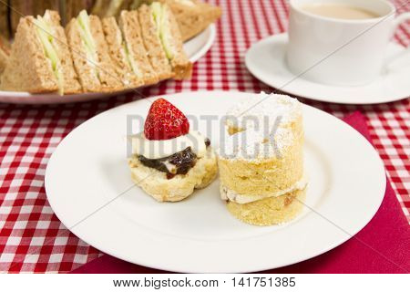 Traditional British afternoon tea Various  sandwiches cakes a part of a traditional British afternoon tea