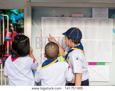 Asian Kid Find  The Result Announcement Of Exam S, Primary School