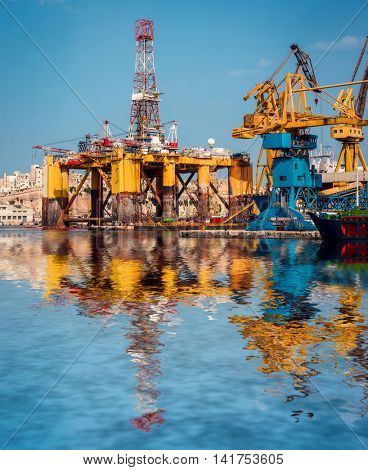 oil offshore platform in repair with reflection, Malta