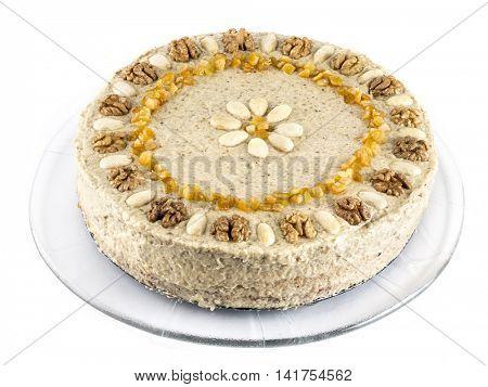 Layer birthday cake with walnut icing shot on white