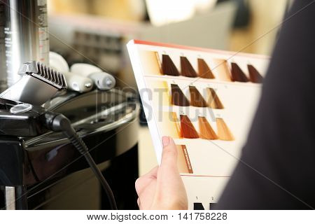 Hairdresser Salon Visitor Hold In Hand Book Of Color Samples