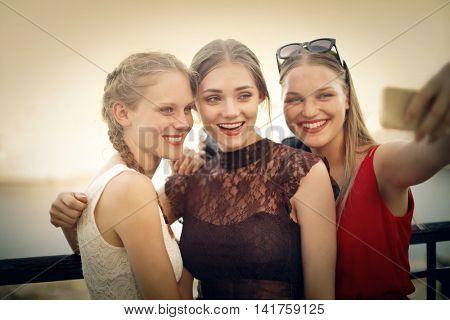 Three blonde girls doing a selfie