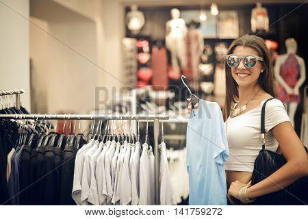 Happy girl doing shopping