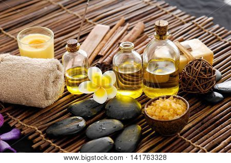 frangipani with stones ,candle, oil ,soap on mat
