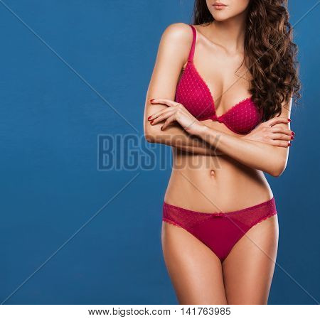 Beautiful sporty woman body. Sexy body of a beautiful woman. Slim tanned woman's body. Beautiful sexy female slim tanned body