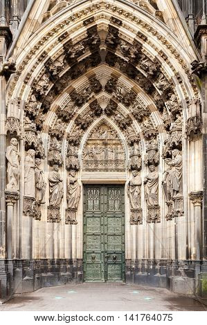 Statues surrounding the west entrance of the Cologne Cathedral. Details of the facade of the main sight of Cologne. The Dom. Germany. Europe