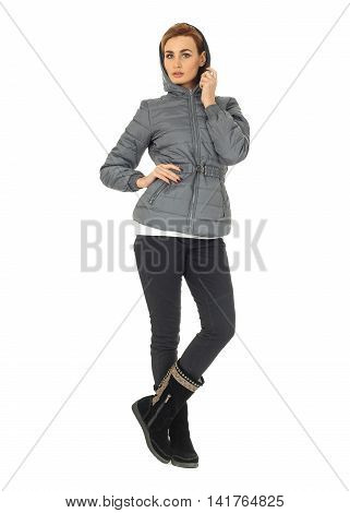Beautiful woman in gray winter coat isolated