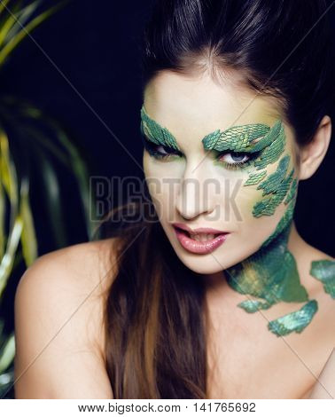 woman with creative make up like snake and rat in her hands, halloween horror closeup joke scary, crazy wild concept