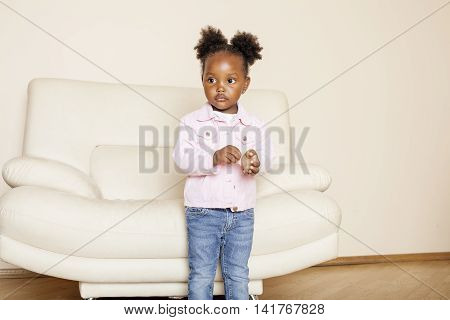 litle cute sweet african-american girl playing happy with toys at home, lifestyle children concept close up