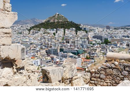 Cityscape of Athens, Greece with Lycabettus Hill at background, shot made from Acropolis wall