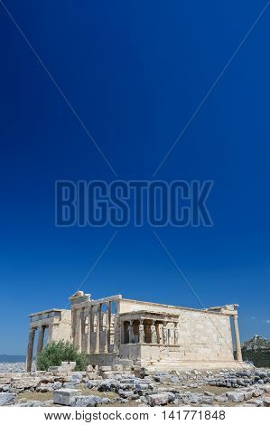 Porch of the Erechtheion with six Caryatids or karyatides at in Acropolis at Athens. Copyspace.
