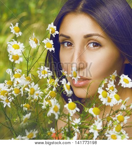 beautiful woman with yellow flowers on forest backgraund