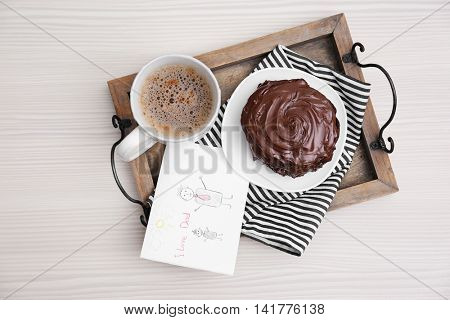 Chocolate pancakes with paint and coffee on table. Happy fathers day concept