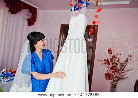Bride On  Blue Gown Looked At The Wedding Dress