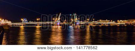 Night panoramic view on illuminated open Blagoveshchenskiy Bridge and Neva River St. Petersburg Russia