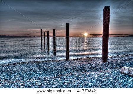 Sunset over the pilings at Point Roberts Washington state USA - HDR picture