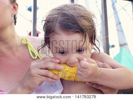 Little Girl Eat Corn.