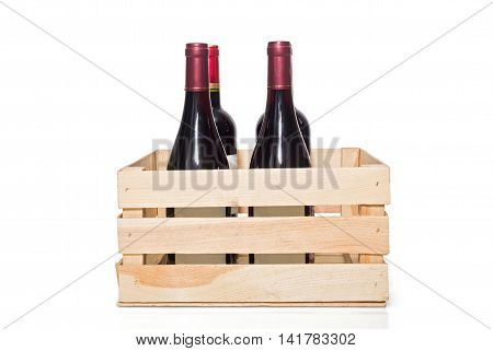 Wine bottle in wooden crate isolated on white