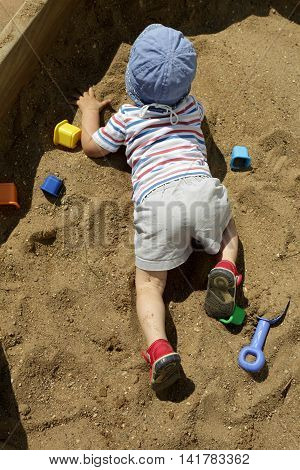 Child Crawling In Sandbox