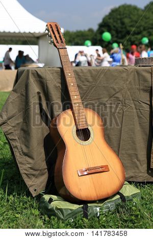 View of guitar in the summer park
