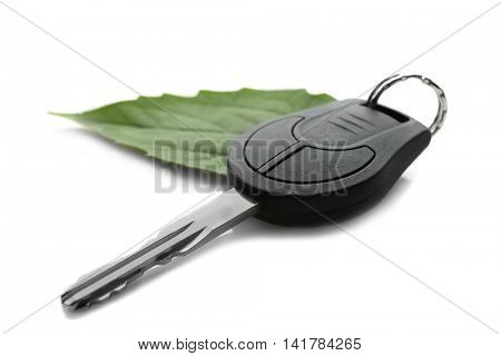 Car key with green leaf, isolated on white