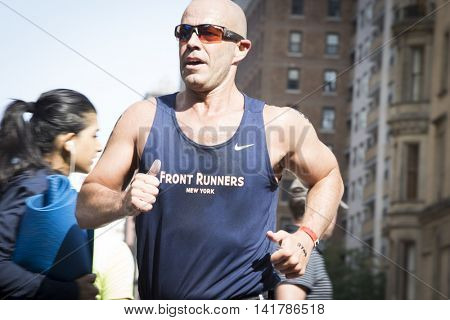 NEW YORK CITY -  JULY 24 2016: Athletes compete in the running portion of the NYC Triathlon Race in Central Park. The run is 10 kilometers and the race is the only International Distance triathlon in the city.