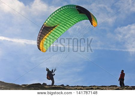 Paraglider launching wing on a Dartmoor hill