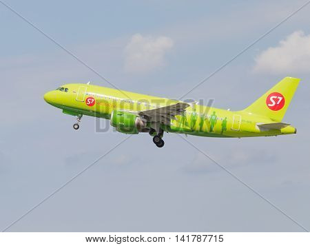 Moscow region - 31 July 2016: Green passenger aircraft Airbus A319-114 S7 Airlines flies to Moscow's Domodedovo airport July 31 2016 Moscow Region Russia