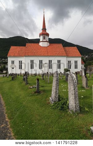 NORDFJORDEYD, NORWAY - JULY 5, 2016: This is typical of the Norwegian Lutheran parish church with a cemetery.