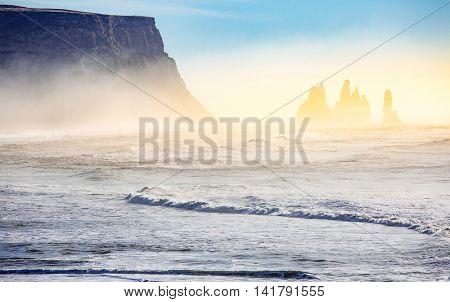 Iceland Reynisdrangar cliffs on Black sand beach in Vik